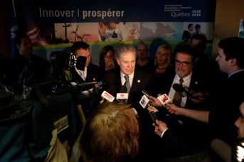 Jean Charest in scrum at Thurso factory