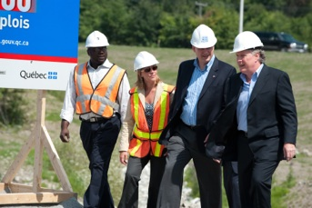 Jean Charest and Stephen Harper walking with workers